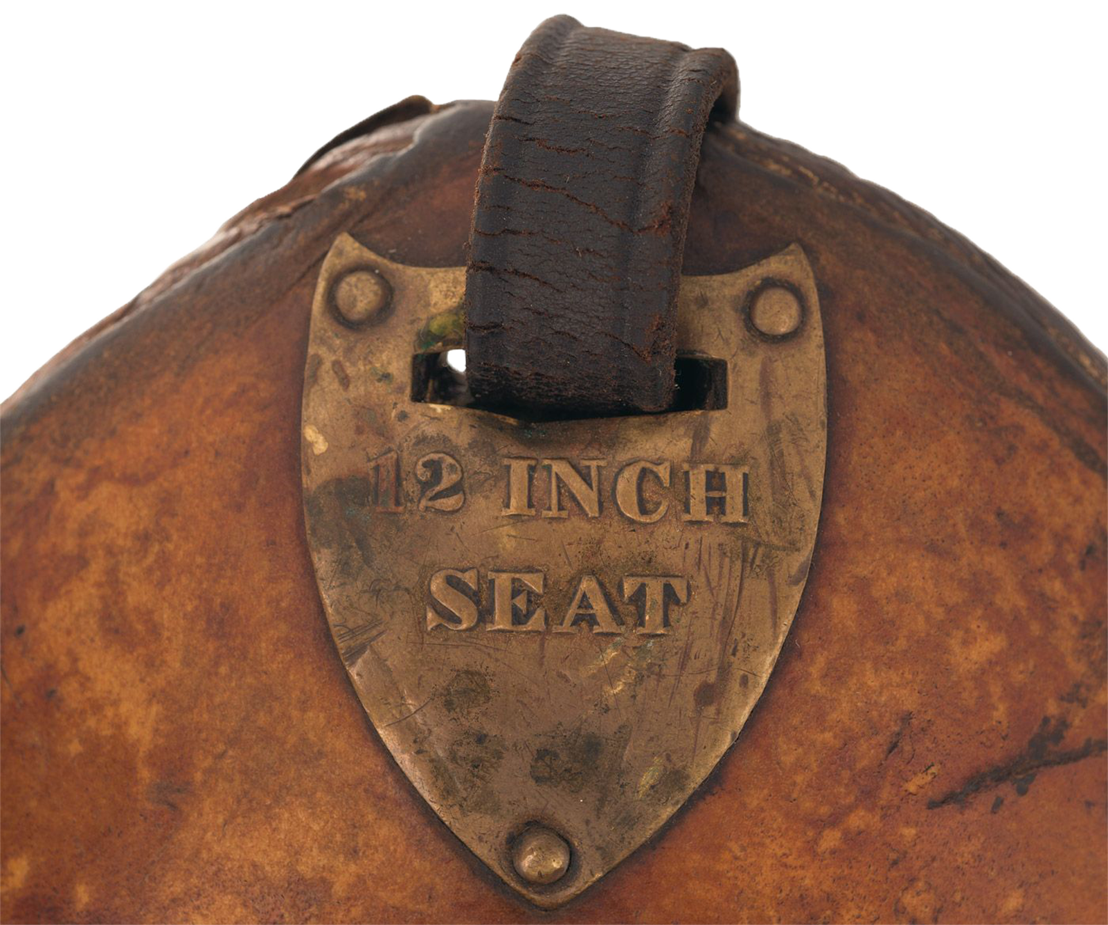 McClellan saddle pommel shield, aged and worn, with 12 inch seat stamped into the medal.
