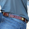man wearing no1 brown leather belt with brass hardware