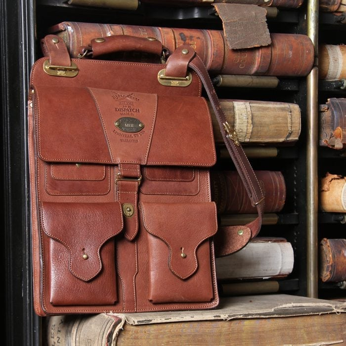 brown american leather dispatch bag with strap on vintage books