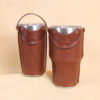 Leather tumbler sleeve for 20 and 30 ounce Yeti Rambler cups in brown sleeve front sitting on table.