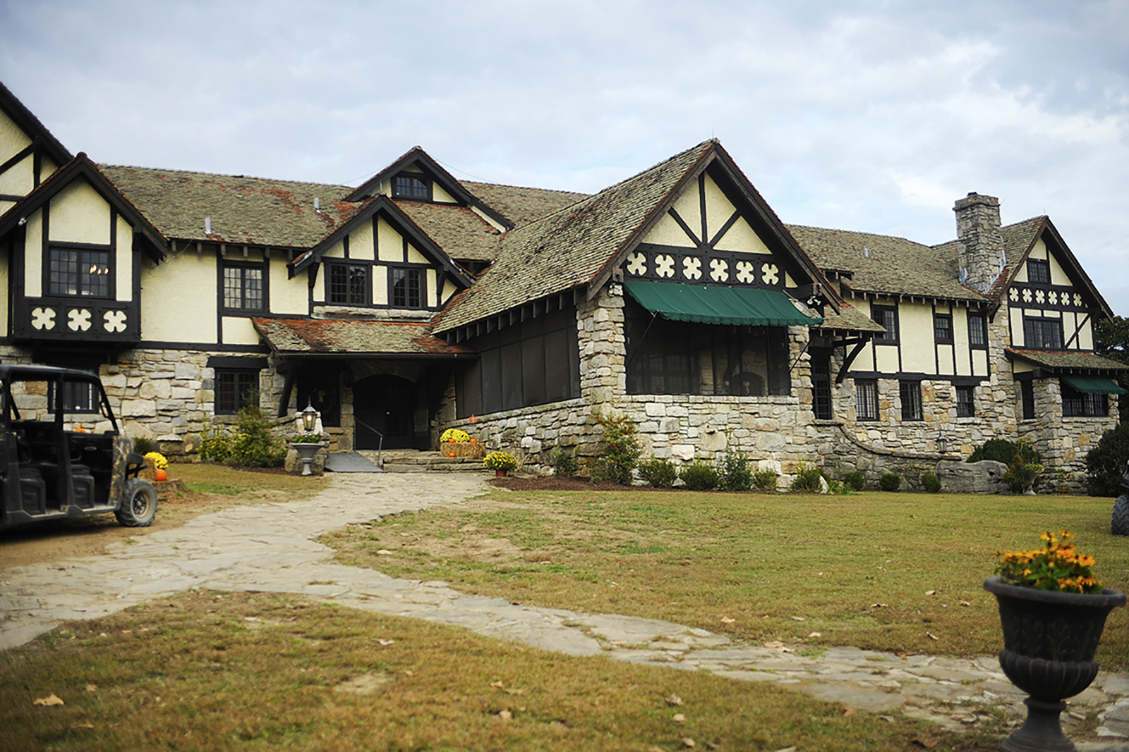 Milky Way manor house with beautiful stone work and dark stained wooden beams and accents.