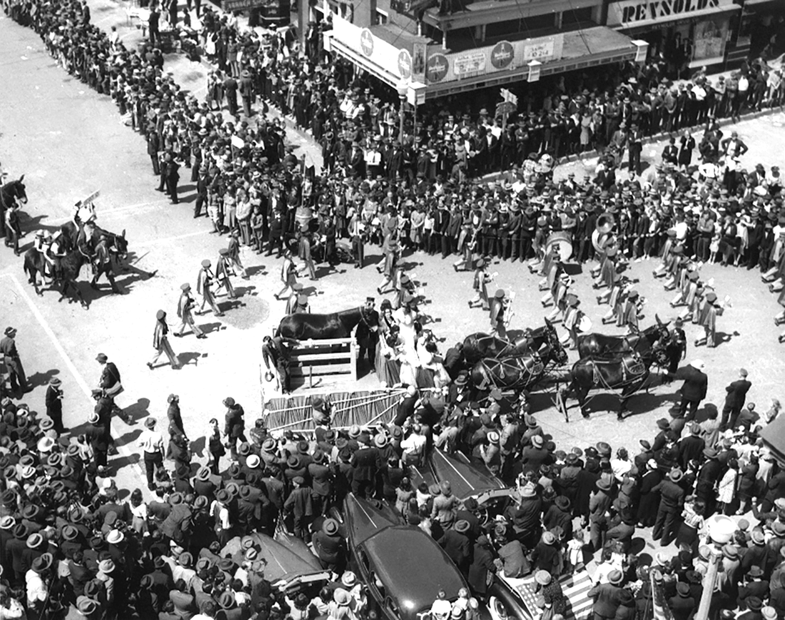 Historical black and white photo, high vantage point view of the Mule Day parade in downtown Columbia, TN