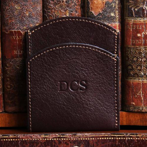 tobacco american buffalo leather front pocket wallet with initial personalization in front of vintage books