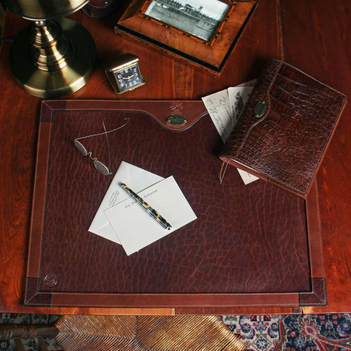no17 tobacco brown american buffalo desk pad on desk with contents