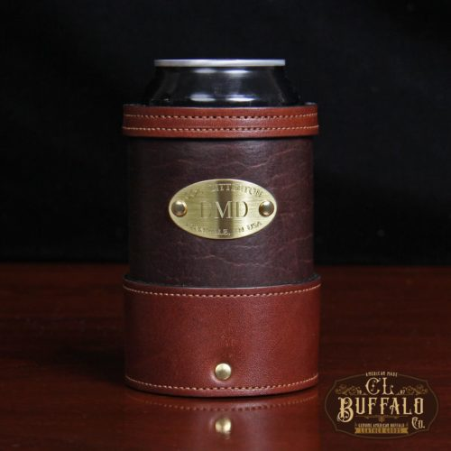 dark brown leather can coozie with soda can in it