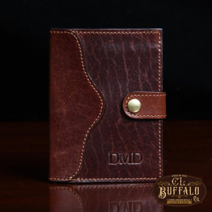 dark brown leather wallet with snap closure